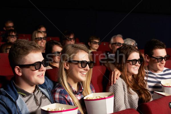 Grupo adolescente amigos assistindo 3D filme Foto stock © monkey_business