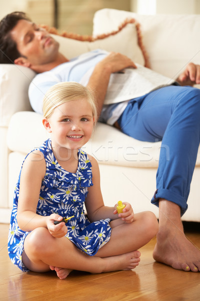 Daughter Painting Sleeping Father's Toenails At Home Stock photo © monkey_business