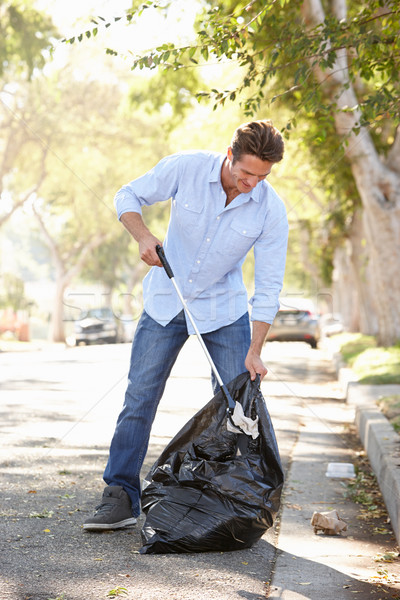 Man Picking Up Litter In Suburban Street Stock photo © monkey_business