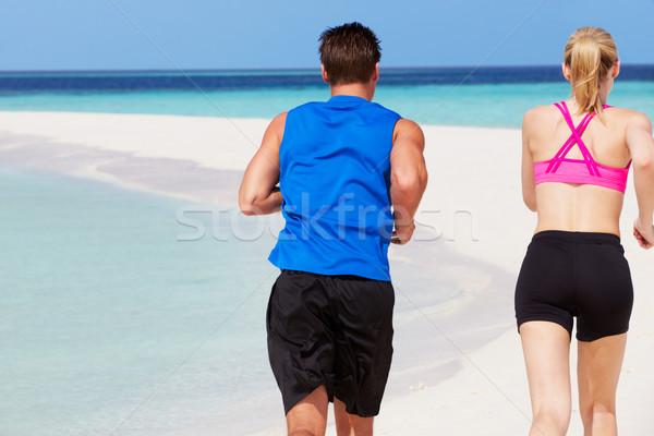 Foto stock: Casal · corrida · belo · praia · mulher