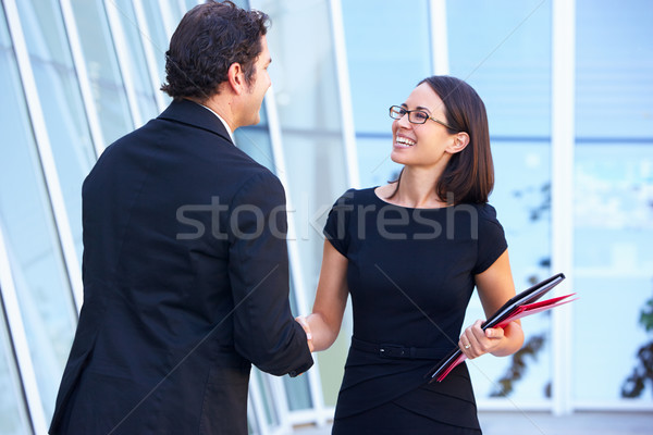 Businessman And Businesswomen Shaking Hands Outside Office Stock photo © monkey_business
