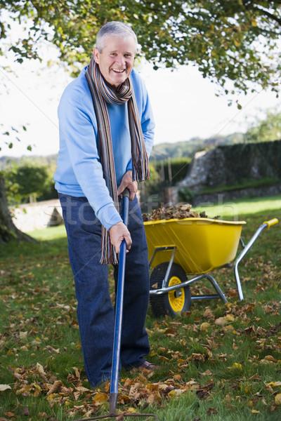 Senior man collecting leaves Stock photo © monkey_business