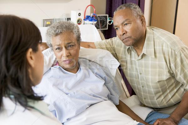 Stock photo: Doctor Talking To Senior Couple
