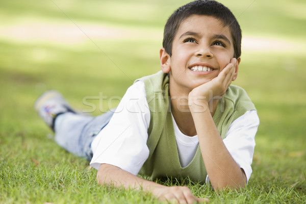 Boy relaxing in park Stock photo © monkey_business