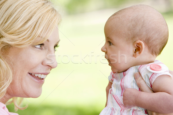 Mother and baby outdoors smiling Stock photo © monkey_business