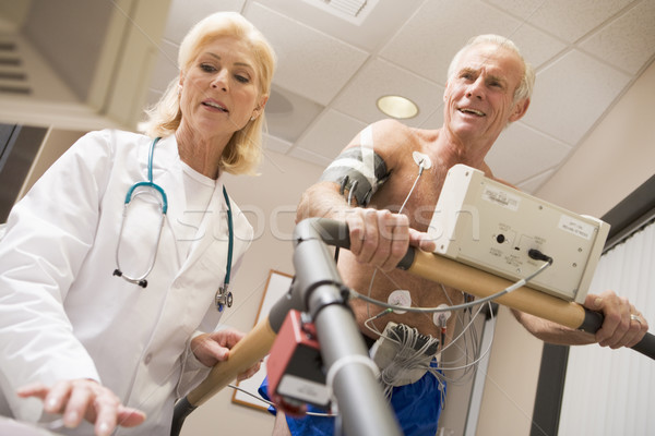 Doctor With Patient While They Run Being Monitored Stock photo © monkey_business