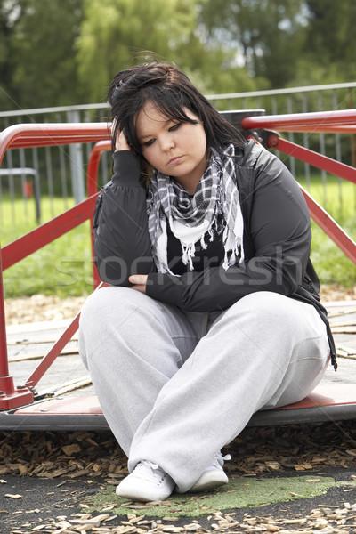 Mulher jovem sessão recreio mulher rua triste Foto stock © monkey_business