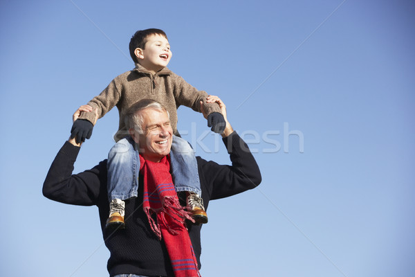 Grandfather Carrying Grandson On His Shoulders Stock photo © monkey_business