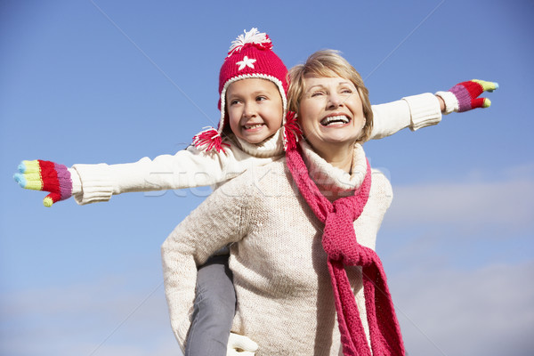 Grandmother Giving Her Granddaughter A Piggy Back Ride Stock photo © monkey_business