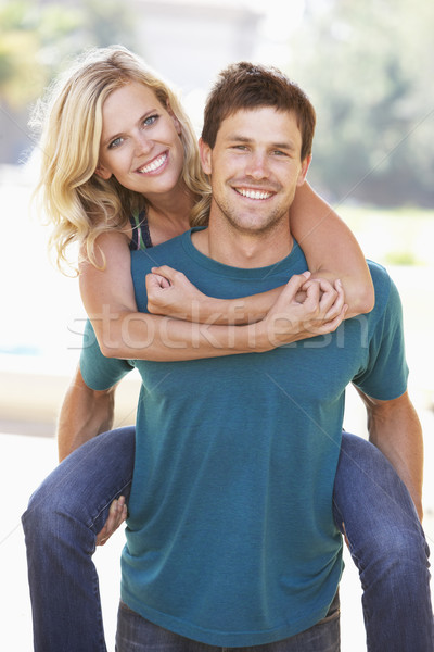 Young Man Giving Woman Piggyback Outdoors Stock photo © monkey_business