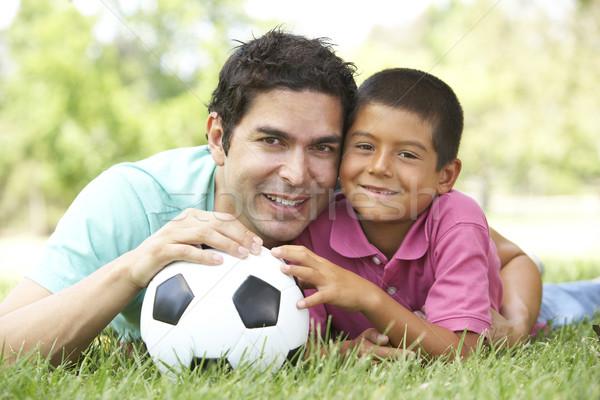 Zdjęcia stock: Syn · ojca · parku · piłka · nożna · piłka · nożna · dziecko · portret