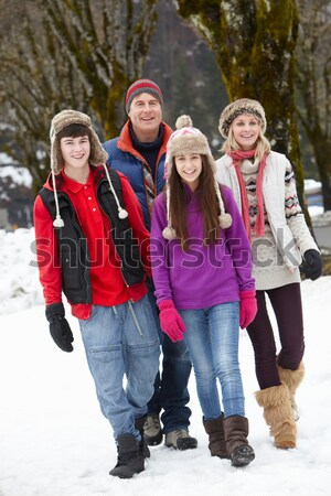 Group Of Young Friends Having Fun In Snowy Landscape Stock photo © monkey_business