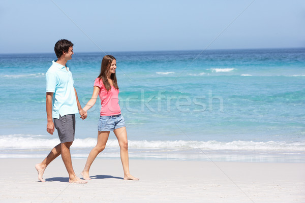 Couple On Holiday Walking Along Sandy Beach Stock photo © monkey_business