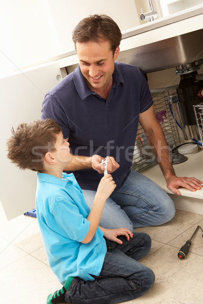 Son Helping Father To Mend Sink In Kitchen Stock photo © monkey_business