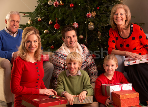Three Generation Family Opening Christmas Gifts At Home Stock photo © monkey_business