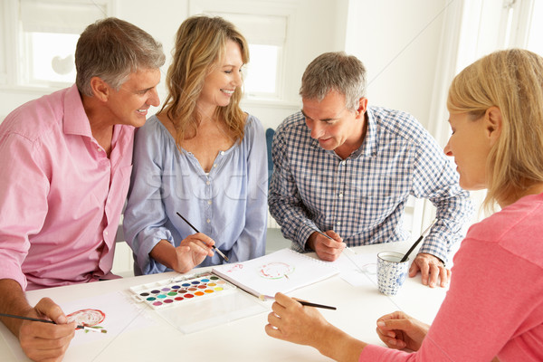 Mid age couples painting with watercolors Stock photo © monkey_business