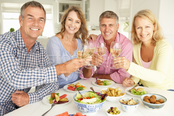 Mid age couples enjoying meal at home Stock photo © monkey_business