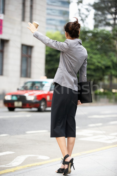 Businesswoman Hailing Taxi In Busy Street Stock photo © monkey_business