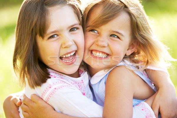 Dwa młodych dziewcząt jeden inny przytulić Zdjęcia stock © monkey_business