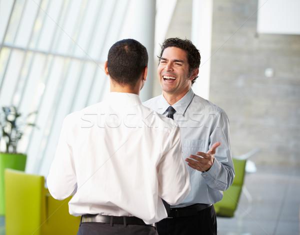 Two Businessmen Having Informal Meeting In Modern Office Stock photo © monkey_business