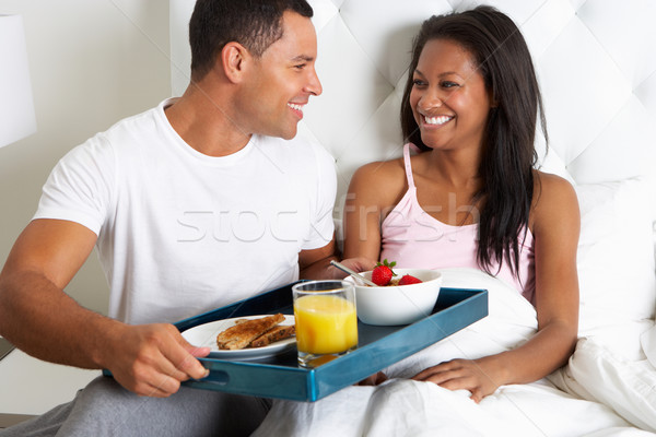 Man Bringing Woman Breakfast In Bed On Tray Stock photo © monkey_business