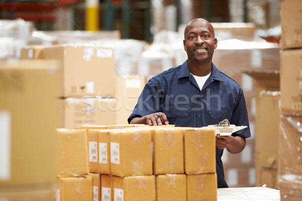 Worker In Warehouse Preparing Goods For Dispatch Stock photo © monkey_business