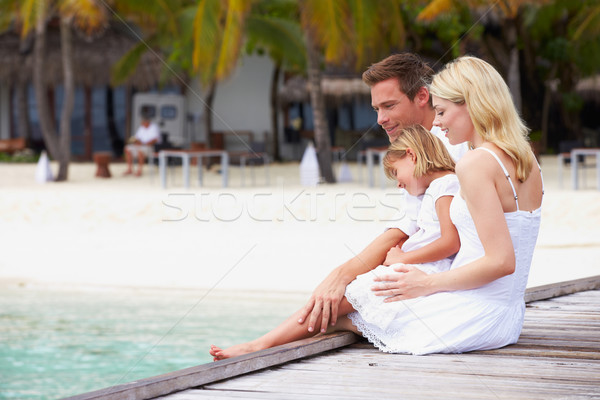 Family Sitting On Wooden Jetty Stock photo © monkey_business