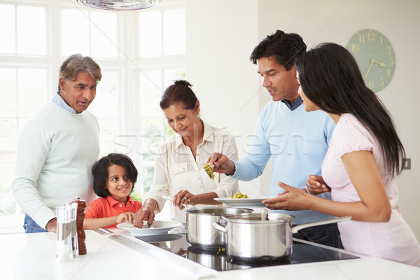 Multi Generation Indian Family Cooking Meal At Home Stock photo © monkey_business