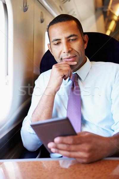üzletember ingázás vonat olvas könyv férfi Stock fotó © monkey_business