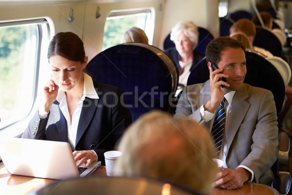 Empresária pendulares trabalhar trem usando laptop homem Foto stock © monkey_business