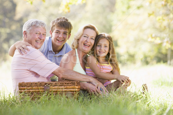 Grands-parents pique-nique petits enfants femme famille enfant Photo stock © monkey_business