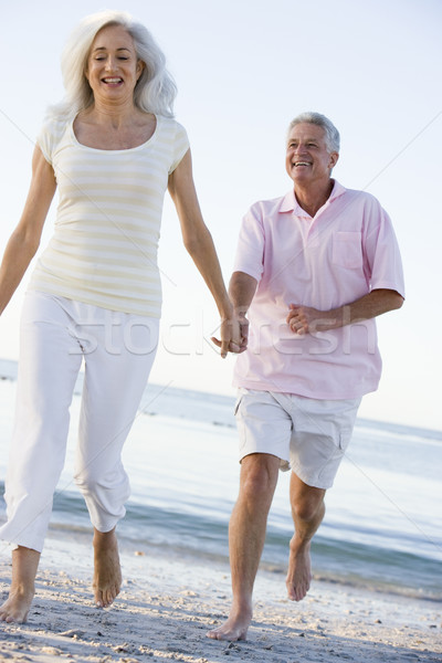 Couple plage mains tenant souriant courir vacances Photo stock © monkey_business