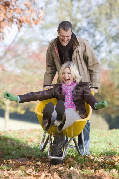 Man pushing wife in wheelbarrow Stock photo © monkey_business