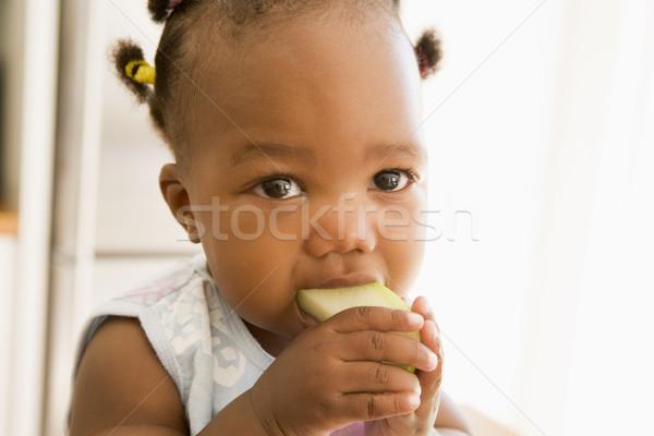 Young girl eating apple indoors Stock photo © monkey_business