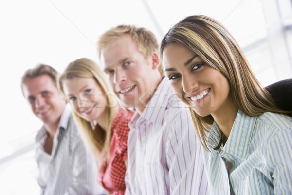 Stock fotó: Négy · üzletemberek · ül · bent · mosolyog · férfi