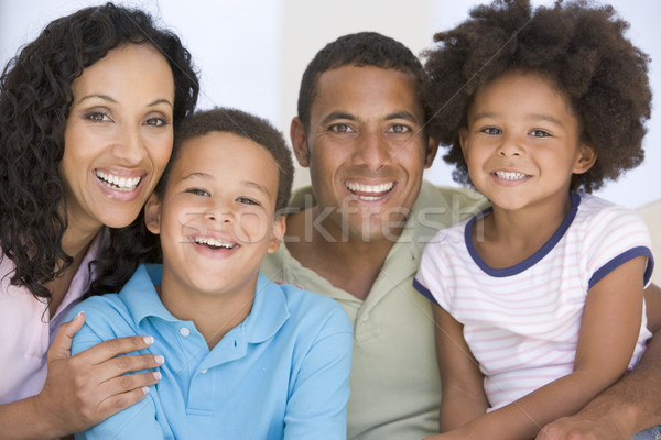 Family in living room smiling Stock photo © monkey_business