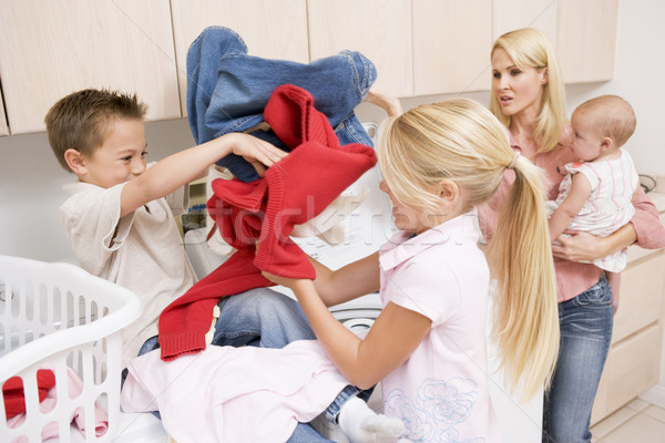 Siblings Fighting While Doing Laundry  Stock photo © monkey_business