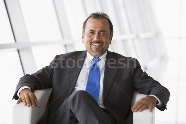 Businessman sitting in office lobby Stock photo © monkey_business