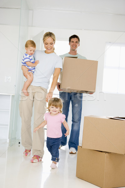 Family with box moving into new home smiling Stock photo © monkey_business