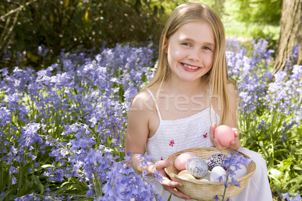 Young girl outdoors holding various eggs in basket smiling Stock photo © monkey_business