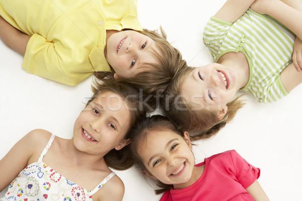 Foto d'archivio: Cerchio · quattro · giovani · amici · sorridere