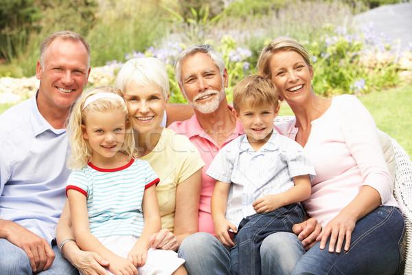 Famiglia allargata rilassante giardino famiglia bambini uomo Foto d'archivio © monkey_business