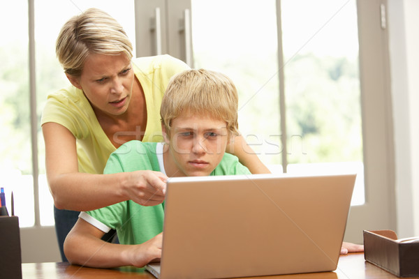 Angry Mother And Teenage Son Using Laptop At Home Stock photo © monkey_business