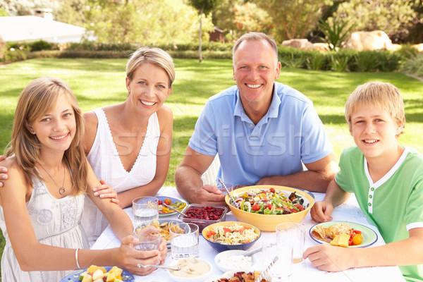 Stockfoto: Familie · genieten · maaltijd · tuin · vrouw · kinderen