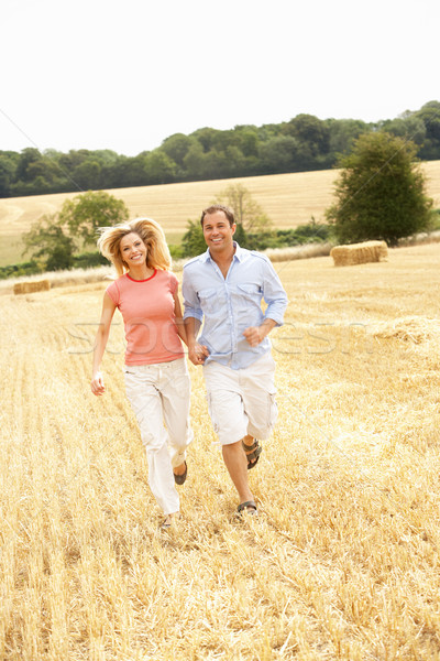 Couple Running Together Through Summer Harvested Field Stock photo © monkey_business