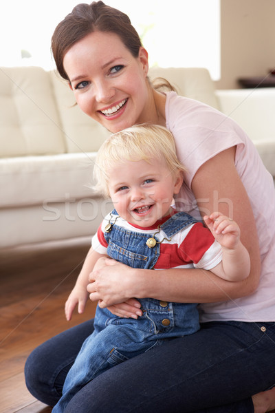 Mother Cuddling Son At Home Stock photo © monkey_business