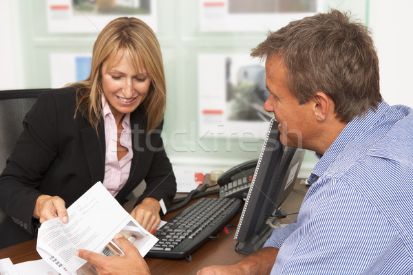 Female Estate Discussing Property Details With Client Stock photo © monkey_business