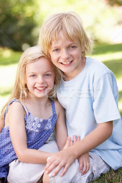 Brother and sister pose in a park Stock photo © monkey_business