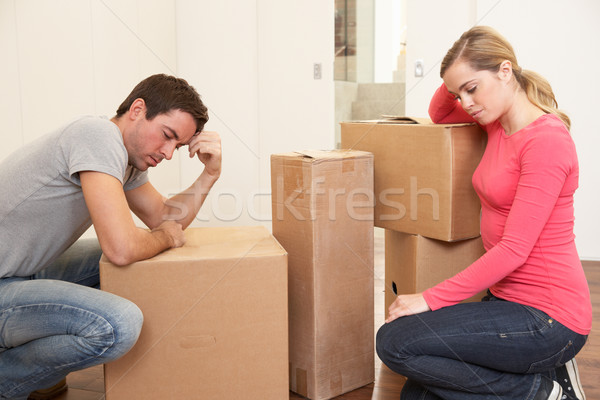 Young couple looking upset among boxes Stock photo © monkey_business