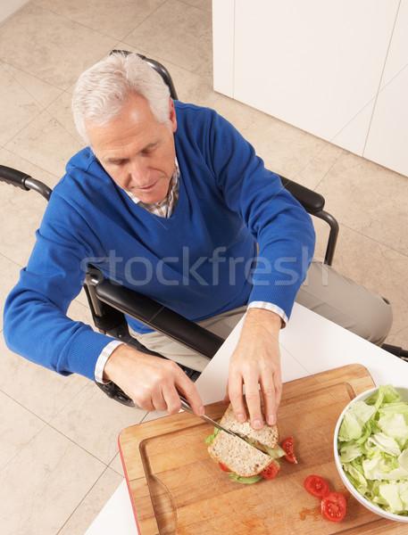 Disabled Senior Man Making Sandwich In Kitchen Stock photo © monkey_business